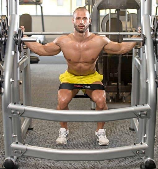 Man using StarkTape Hip Circle Band for Squatting and Lifting